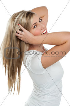 Flirtatious pretty girl playing with her hair