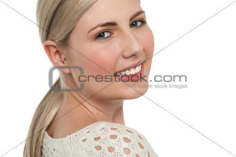 Tight face closeup of smiling teen blonde girl