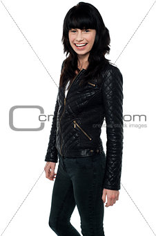 Beautiful girl in a stylish leather jacket