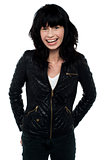 Young girl wearing trendy leather jacket, style icon