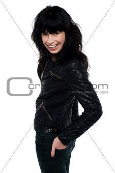 Beauty brunette woman in leather jacket