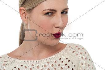 Flirtatious teen watching you closely
