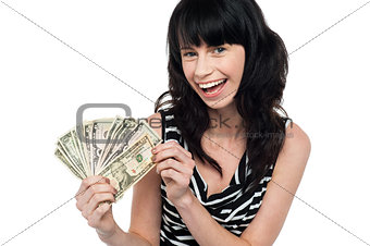 Attractive young woman holding money