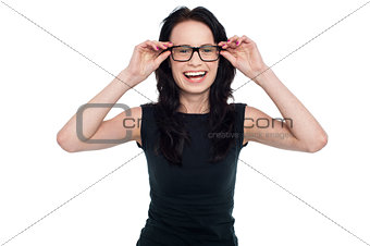 Charming lady adjusting her eyeglasses