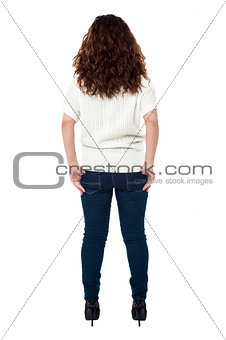 Back view of a long haired woman over white