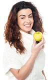 Joyous woman with an apple in hand