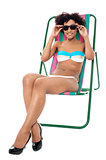 Fashion lingerie model relaxing on deckchair