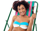 Glamorous woman in lingerie relaxing on a deckchair