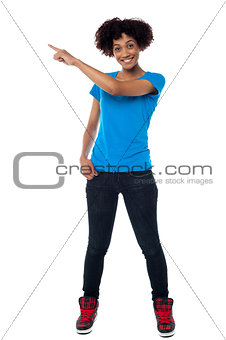 Attractive young woman pointing sideways