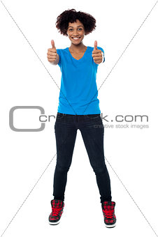 Beautiful trendy woman showing double thumbs up