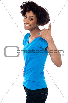 Attractive young model gesturing a mock call