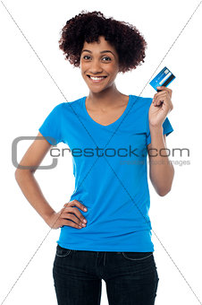 Beautiful female mode hlolding up cash card
