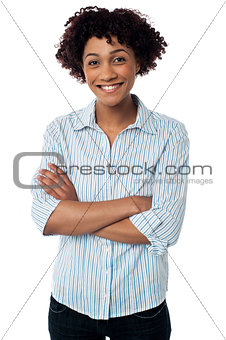 Causual smiling woman with folded arms