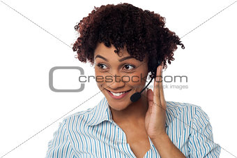 Casual shot of a call centre executive looking away