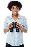 Smiling afro american woman holding binocular