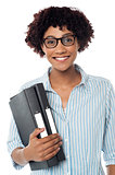 Bespectacled woman in casuals holding files