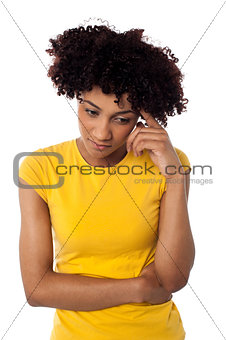 Calm and thoughtful curly haired young woman
