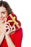 Woman holding heart shaped gift