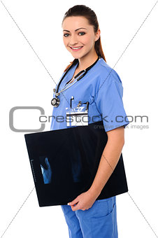 Attractive doctor holding x-ray report