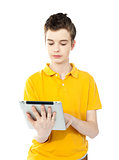 Young caucasian kid working on tablet pc