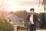 Businesswoman standing on the Street with bike