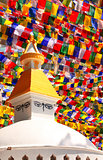 Stupa with Buddha eyes and prayer flags, Kathmandu, Nepal