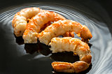 Fried shrimps on the black background
