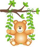 Teddy bear in a swing