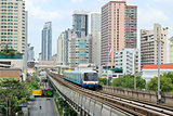 Sky train railway in Bangkok with business building