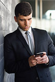 Young businessman on the phone in an office building