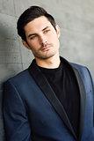 Handsome man, model of fashion, wearing modern suit.
