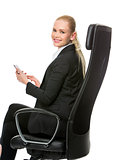 businesswoman seated on a chair working with tablet