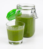 Green Smoothie In A Glass And In A Open Jar