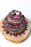 Sweet beautiful cake whit fruits on white