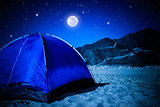 Camp tent on the beach at night