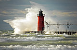 red lighthouse with big wave