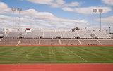 College Level Track Stadium Puffy Clouds Blue Sky