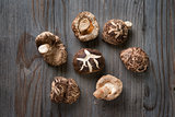 Shiitake mushrooms on wood background