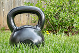 heavy iron  kettlebell in backyard