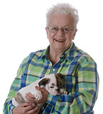 senior woman and puppy