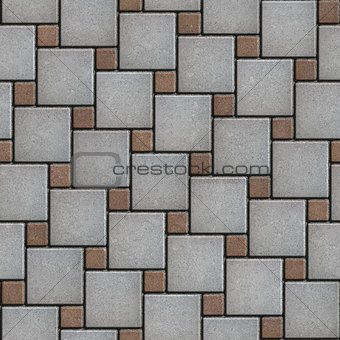 Gray-Brown Paving Slabs Laid Alternately Large and Small Squares.