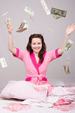 The girl on bed falling banknotes