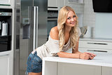 beauty blond girl in her white kitchen
