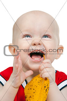 Portrait of infant boy with yellow autumn leaves
