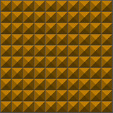 wall with orange pyramid tiles pattern
