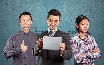 Asian team and Businessman With Touch Pad