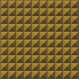 wall with ochre yellow pyramid tiles pattern