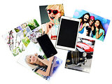 tablet, telephone and printed photos