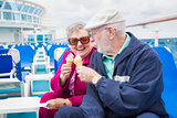 Senior Couple Enjoying Ice Cream On Deck Of Cruise Ship