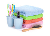 Four toothbrushes, liquid soap, hairbrush and colorful towels